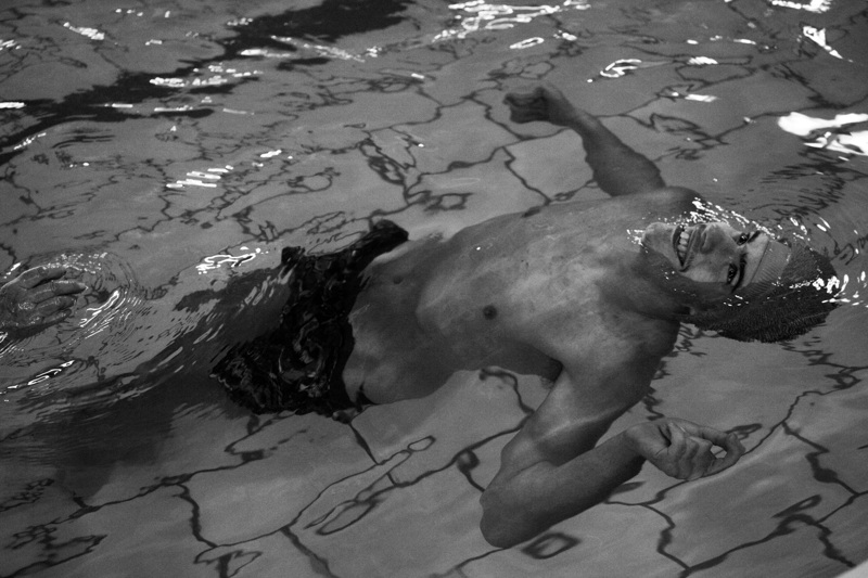 Other children.  A child in the swimming pool during swimming lessons in Moscow